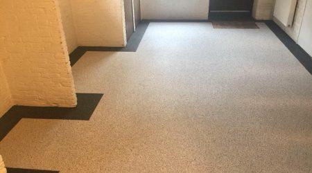 Grindvloer strak afgewerkt met sierrand| Van Winkel vloeren